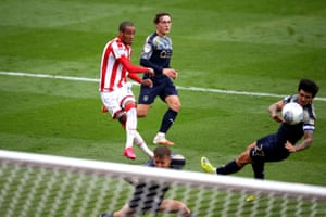 Stoke City's Tom Ince (left) scores his side's fourth goal.