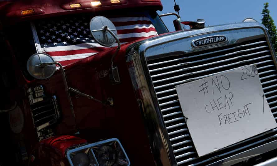 A sign is placed on a semi-trailer truck as truckers protest about low rates and lack of broker transparency during the coronavirus pandemic in Washington on Friday.