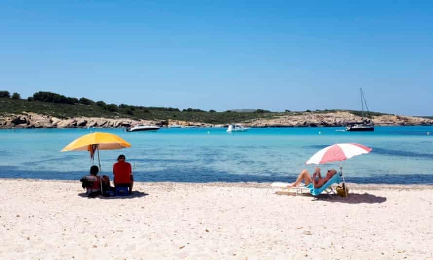 Beachgoers in Menorca, one of the Balearic islands