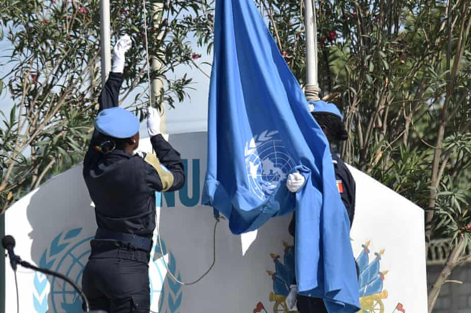 The UN flag is raised at the opening ceremony of the UN Mission in Support of Justice in Port-au-Prince, Haiti.