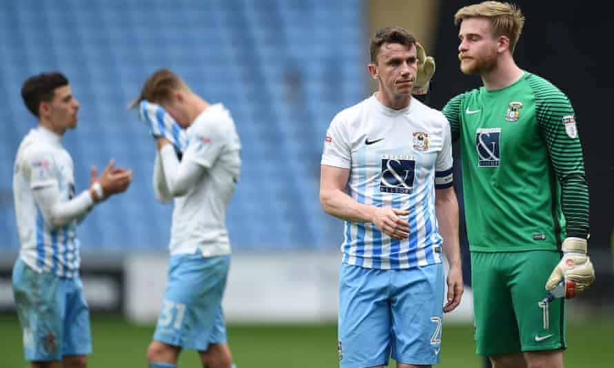 Dejected Coventry City players at the final whistle after their relegation was confirmed.