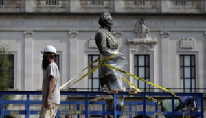 A statue of Confederate President Jefferson Davis is moved from its location in front of the school's main tower the University of Texas campus in August 2015