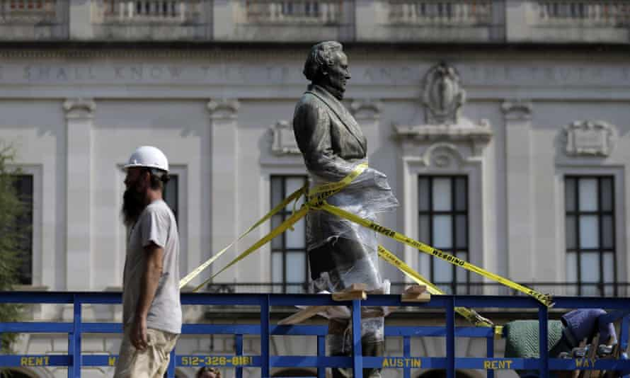 A statue of Confederate President Jefferson Davis is moved from its location in front of the school's main tower the University of Texas campus.