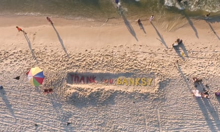Artists in Gaza carved the words 'Thank you Banksy' in sand.