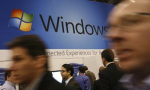 People in front of Microsoft Windows sign