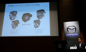Mazda Motor president Masamichi Kogai shows a slide about its new engine Skyactiv-X, in Tokyo, Japan.