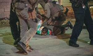 Police detain a protester last night in Louisville, Kentucky.