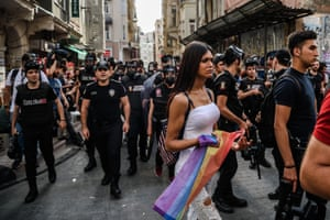A woman holds a rainbow flag as Turkish anti-riot police disperse demonstrators gathered for a rally staged by the LGBT community in Istanbul in 2016