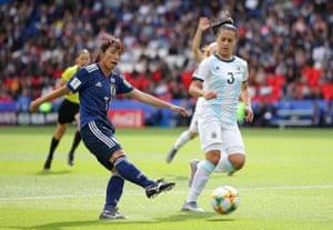 Emi Nakajima of Japan shoots under pressure from Eliana Stabile of Argentina.