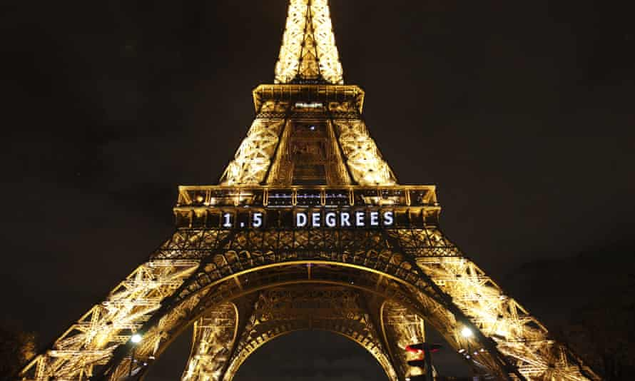 """The slogan """"1.5 Degrees"""" is projected on the Eiffel Tower as part of the World Climate Change Conference 2015 (COP21) on December 11, 2015 in Paris, France."""