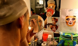 An actor gets ready for a show.