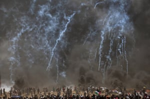 Israeli troops fire teargas at Palestinian protesters during clashes after protests near the border with Israel in the northern part of the Gaza Strip