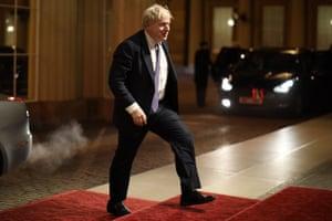 Boris Johnson arrives at the Buckingham Palace reception