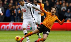 Derby County's Bradley Johnson, left, battles for the ball with João Teixeira, who was the target of ire from the Wolves fans after his early substitution.