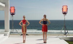 Elle Fanning, left, and Bella Heathcote on the set of Nicolas Winding Refn's The Neon Demon.