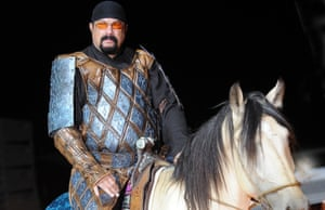 Steven Seagal rides a horse at the opening of the World Nomad Games.