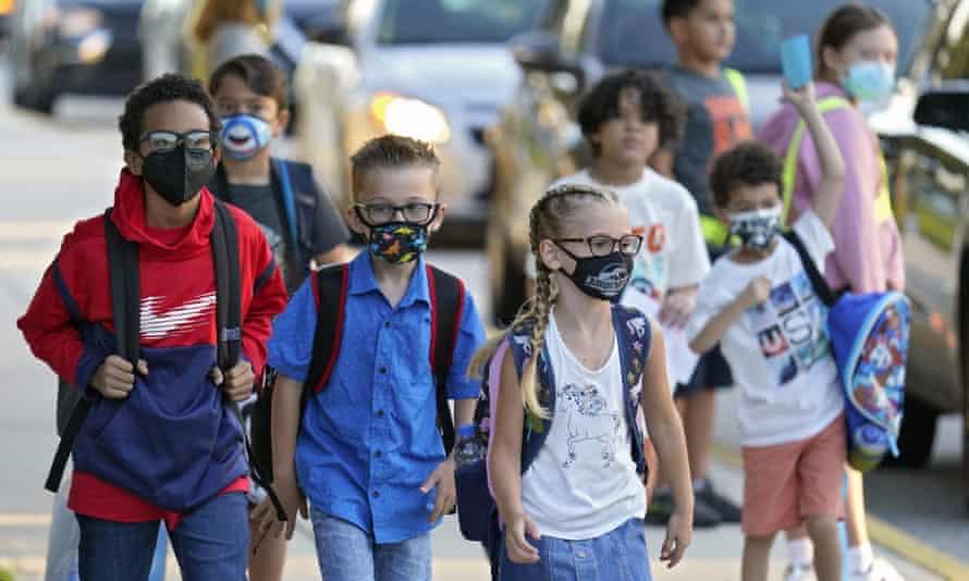 children walk to school with masks on