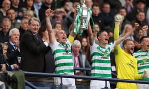 Celtic's Scott Brown celebrates with the trophy after winning the Scottish Cup final.