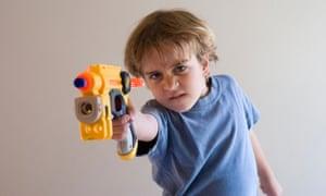 A boy with a Nerf gun.