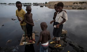 Children of the fishermen play in the lagoon