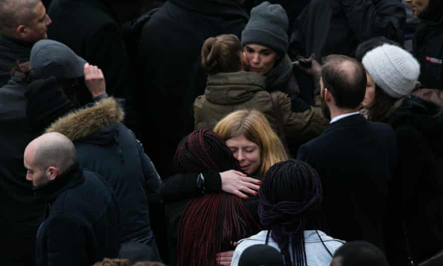 Members of the crowd share their grief.
