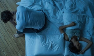 Couple struggle to sleep.