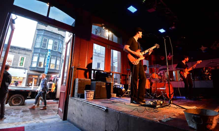 At SXSW, a band plays in a bar on sixth street. Some say the gentrification of Austin's downtown evokes that of New York's East Village.