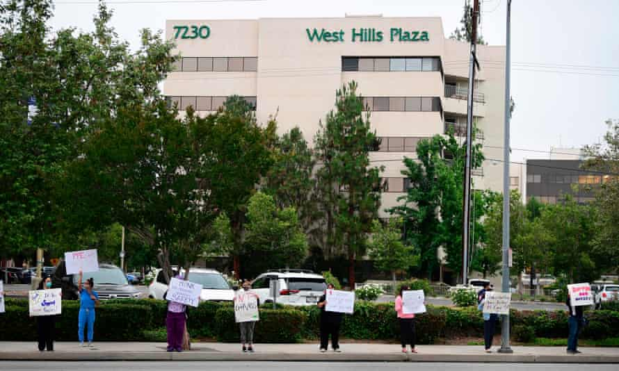 Nurses stage a protest with support from the registered nurses union, SEIU Local 121RN, outside the West Hills Hospital on 18 June in West Hills, California.