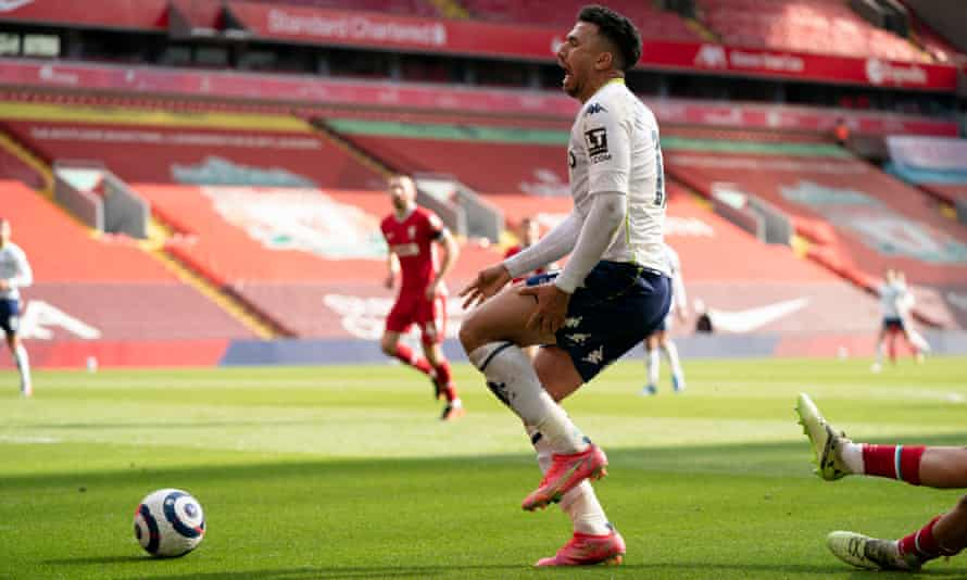 Aston Villa's Mahmoud Trézéguet reacts to being tackled by Liverpool's Trent Alexander-Arnold