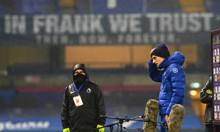 Thomas Tuchel takes post-game questions at Stamford Bridge with an 'In Frank We Trust' banner in the background.