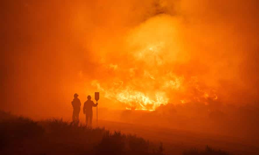 Firefighters at the site of a wildfire between Navalacruz and Riofrio, central Spain.