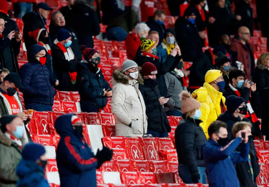 Arsenal fans at the Emirates for a Europa League match against Rapid Vienna in December, during the short-lived return of crowds