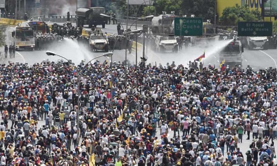 Protestors block the highway in Caracas.