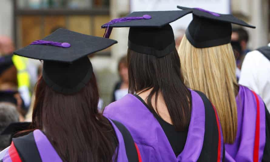 University graduates at a graduation ceremony.