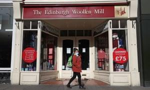 A closed Edinburgh Woolen Mill shop on Princes Street in Edinburgh.