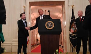 Trump congratulates Brett Kavanaugh on his swearing-in as a supreme court justice in October.