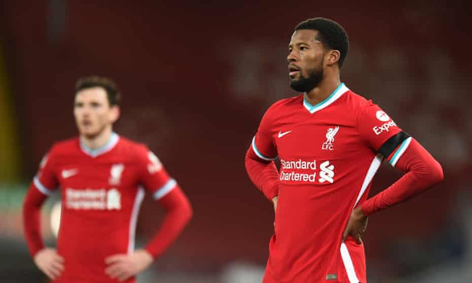 Georginio Wijnaldum and Andrew Robertson react to Chelsea's goal at Anfield.