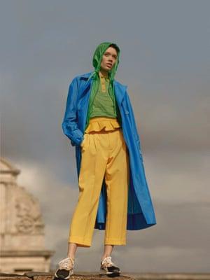 Brynn wears garden jacket, £260, maje.com; spring trench coat, £955, tibi.com; yellow leather belt, £340, maxmara.com; yellow trousers, £440, Plan C, brownsfashion.com; Bolton Lo trainers, £199.95, Victoria beckham x Reebok, victoriabeckham.com, and top, £260, I am Chen, brownsfashion.com