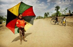 small boy with umbrella in Malawi