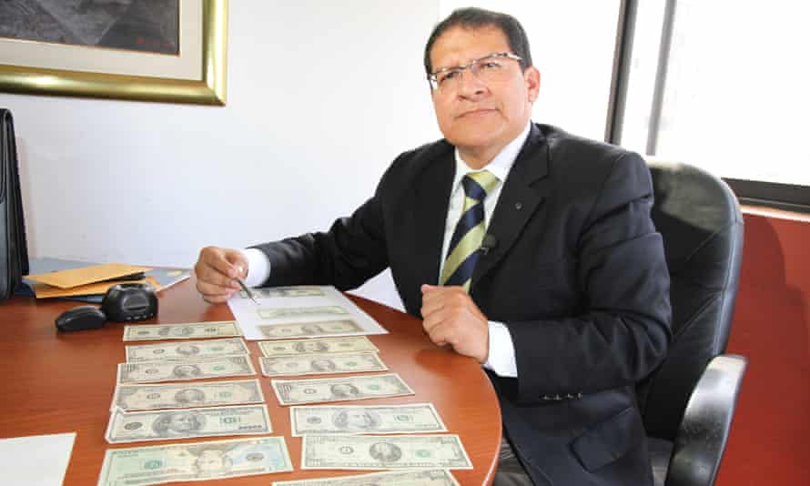Reimundo Urcia, a retired Peruvian police officer who trains civilians and police on how to detect counterfeit bills