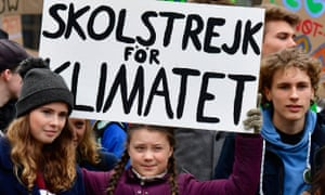 German climate activist Luisa Marie Neubauer (left) and Swedish climate activist Greta Thunberg (centre) demonstrating in Berlin on 29 March