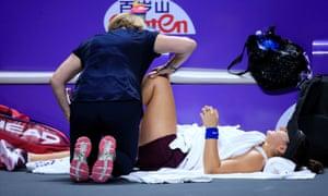 Bianca Andreescu receives medical attention during her match against Karolina Pliskova.