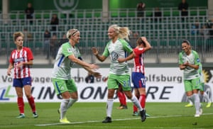Fischer (second left) and Pernille Harder with Wolfsburg last season.