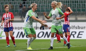 Wolfsburg's Nilla Fischer (left) and Pernille Harder (centre) celebrate after scoring against Atlético Madrid in the Champions League round of 32