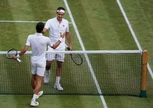 Novak Djokovic greets Roger Federer after winning.