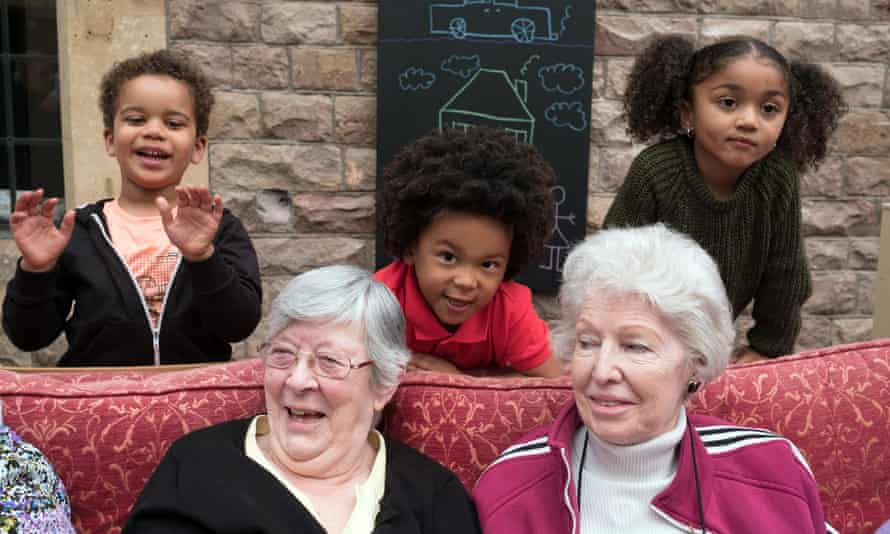 Playtime … pensioners Linda and Mary with Solomon, Nelson and Amiya.