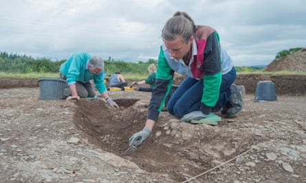 Archaeologists working at the site of the discovery of Roman coins and pottery at Ipplepen, Devon.