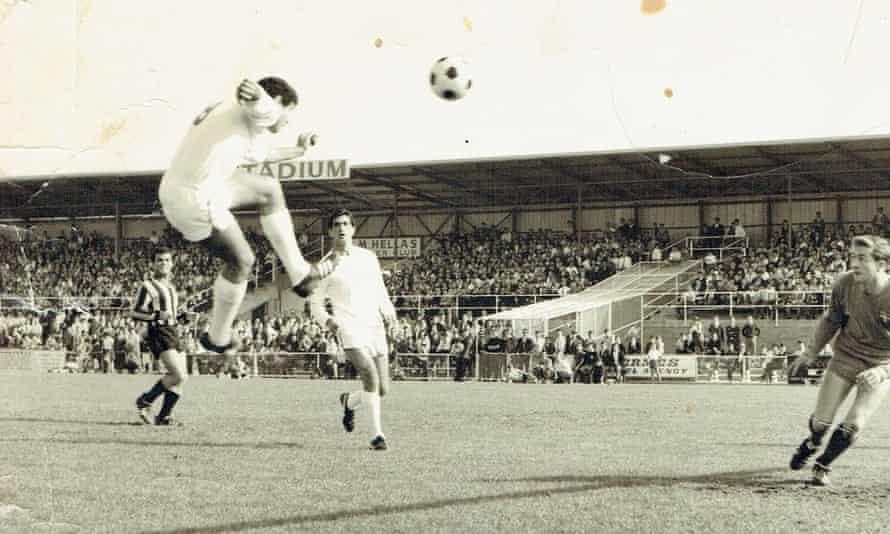 Kokkinos heads the ball goalwards against arch rivals Fitzroy Alexander (now Heidelberg).
