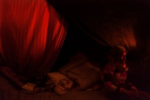 Home, Calais, France, 2015 An Eritrean refugee woman sits in her tent in the refugee camp in Calais, France.