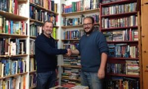 Retiring owner of Bookends bookshop in Cardigan, Paul Morris with new owner Ceisjan van Heerden.